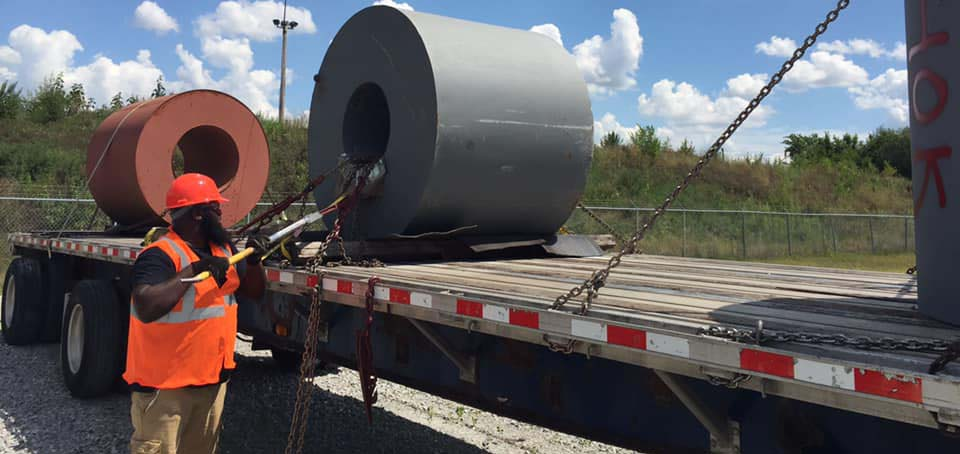 Securing a load to a flatbed trailer